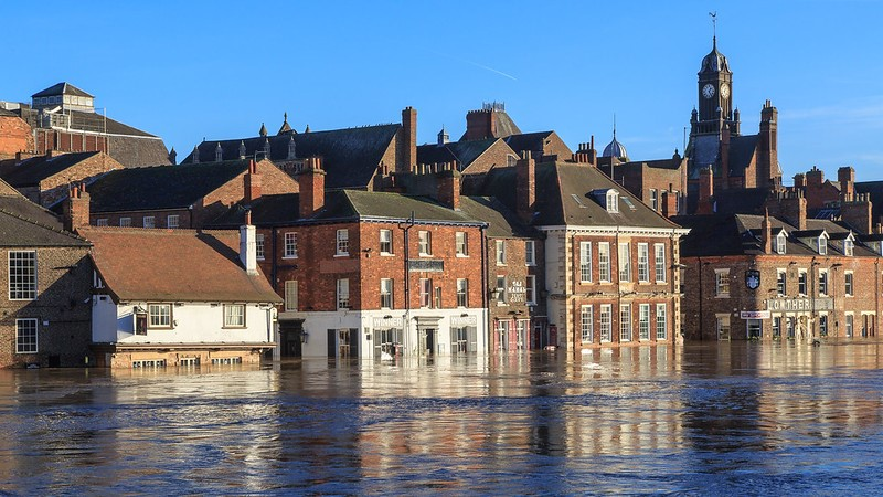 A cluster of houses or buildings submerged in a flood